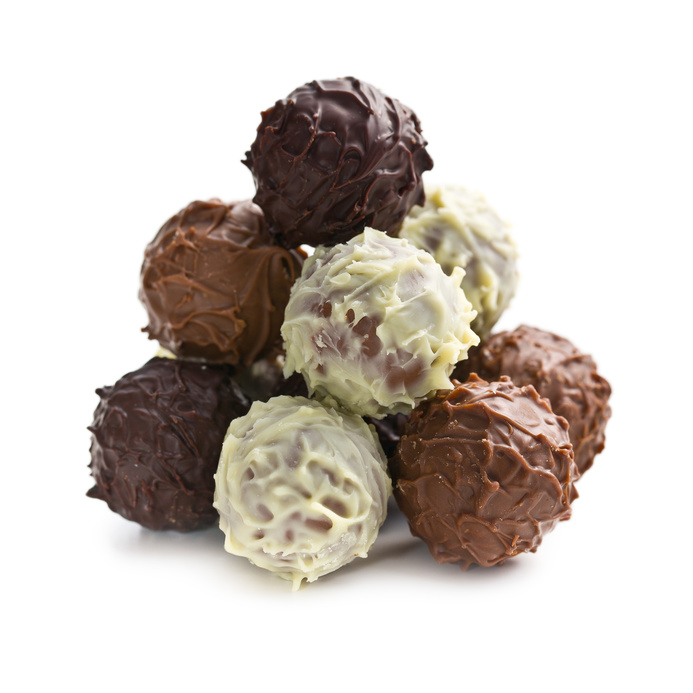 pile of chocolate truffles on white bacgkround